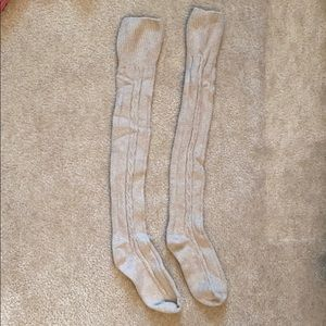 Over the knee knit socks in grey and beige.
